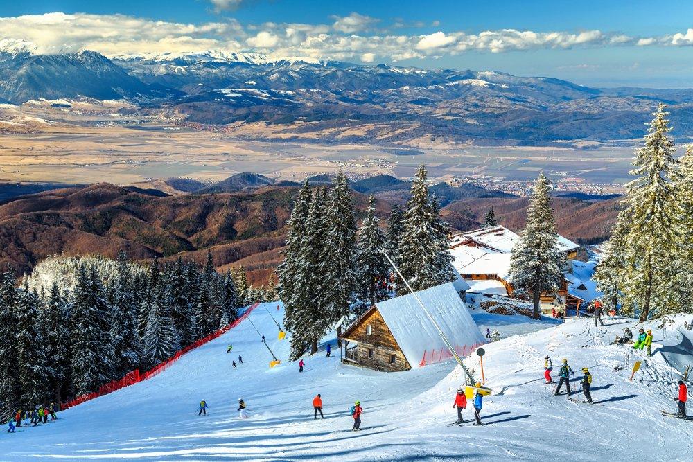Wooden Chalets and Spectacular Ski Slopes in the Carpathians at Poiana Brasov Ski Resort, Transylvania, Romania