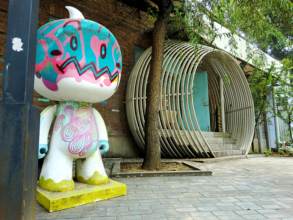 Artistic spray painted graffiti character in 798 Art District, Beijing, China