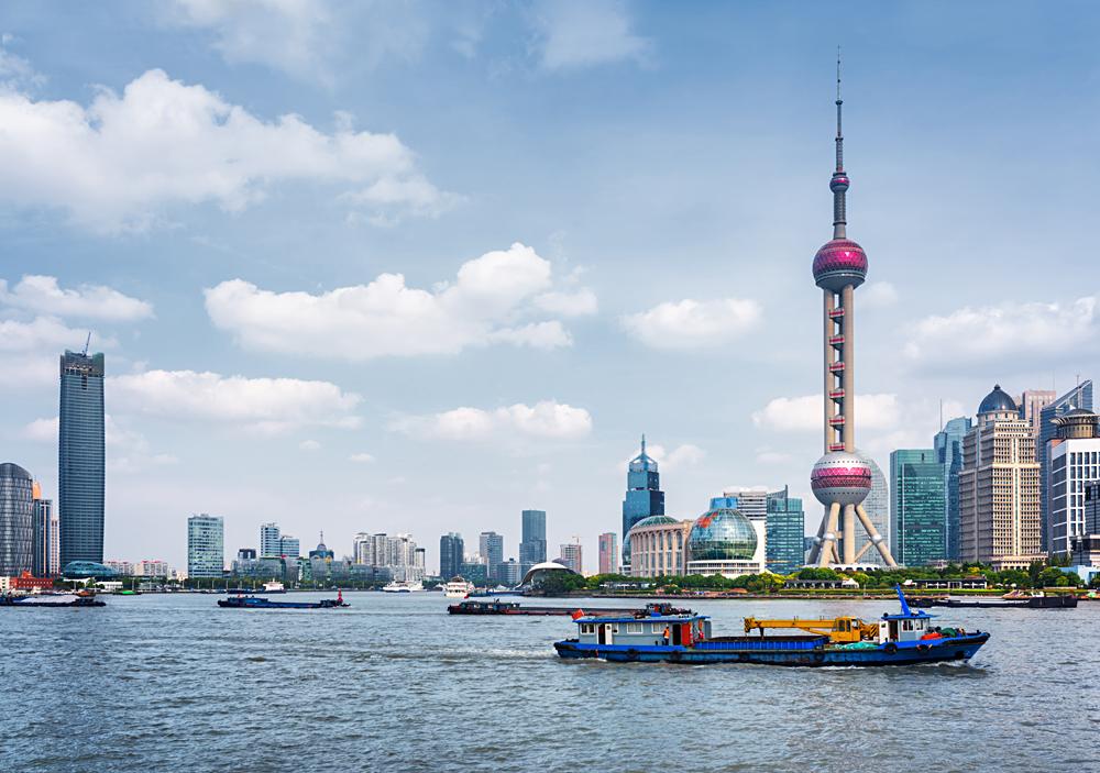 Boats crossing the Huangpu River in Shanghai, China