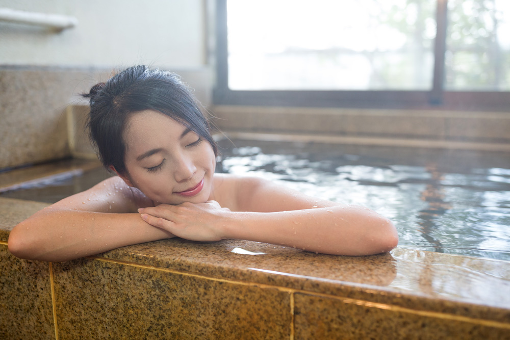 Japanese Woman Enjoying An Onsen, Japan