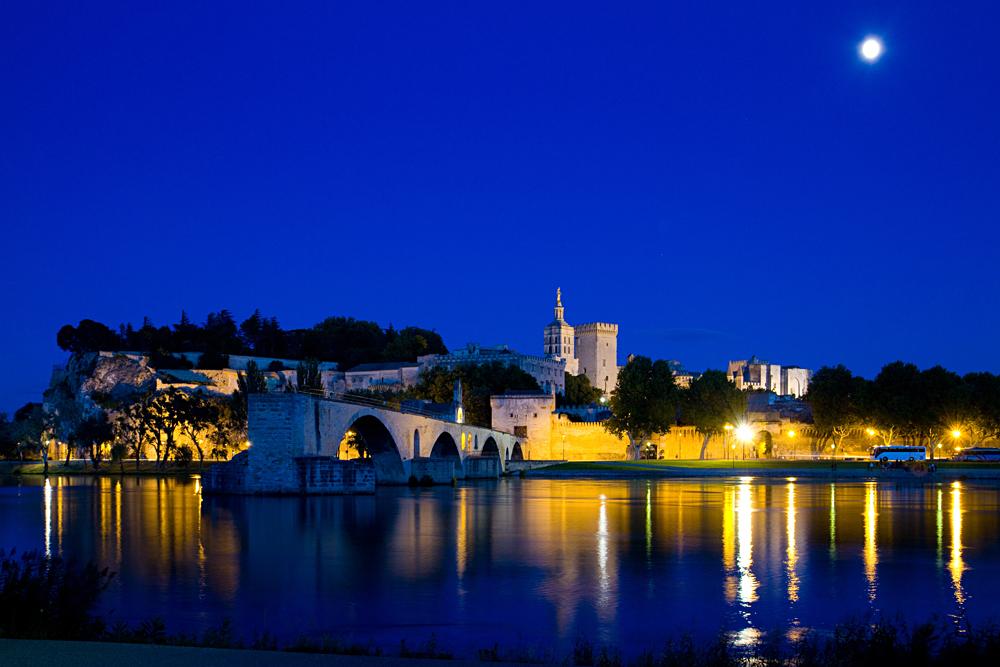 Panoramic view of Avignon Papal Palace (Palais des Papes) and Bridge at night, Avignon, France