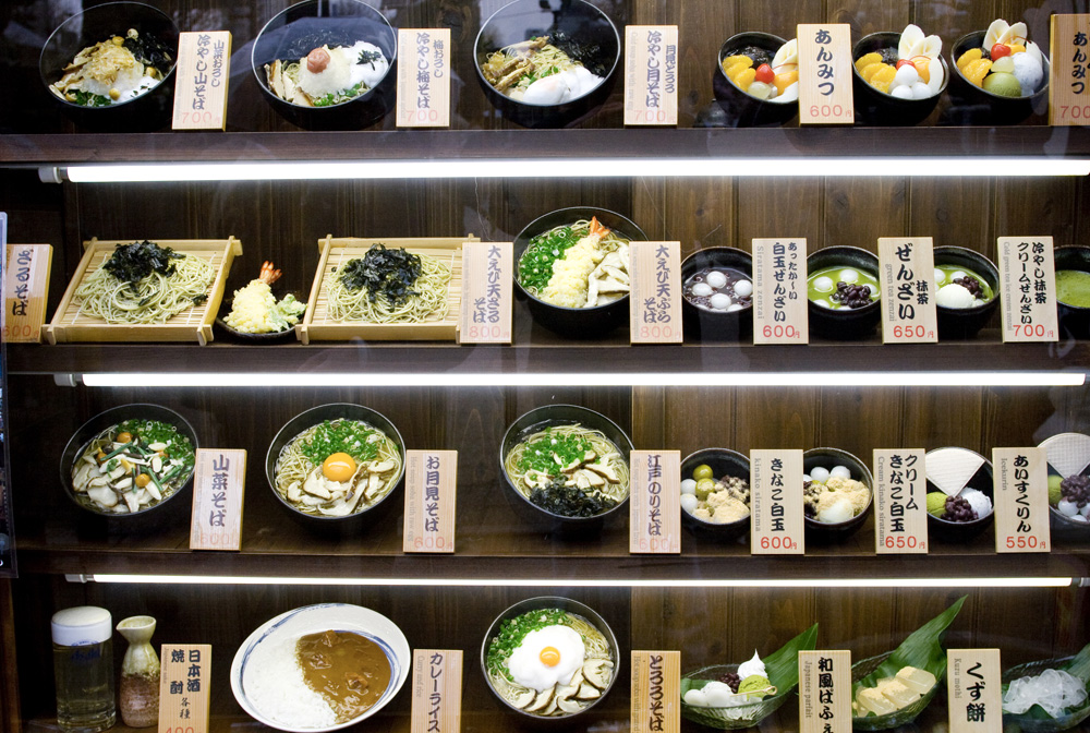 Plastic examples of menus in restaurant window display of a typical restaurant in Japan