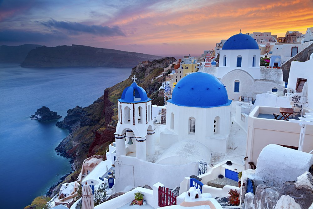 Small Village of Oia at sunset, located on Greek island of Santorini, Greece