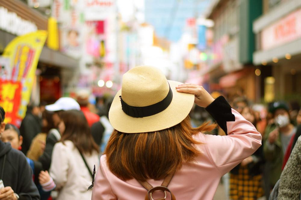 Woman Tourist Walking on Takeshita Street in Harajuku District, Tokyo, Japan