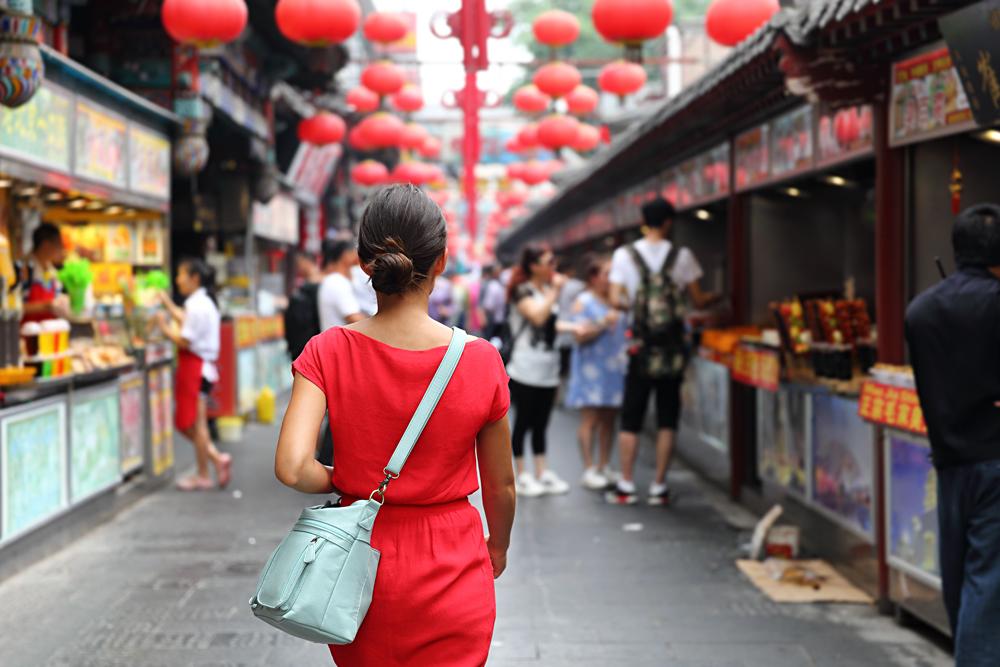 Woman Tourist on Wangfujing food street, Bejing, China