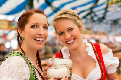 Young women in traditional Bavarian clothes at Oktoberfest, Munich, Germany