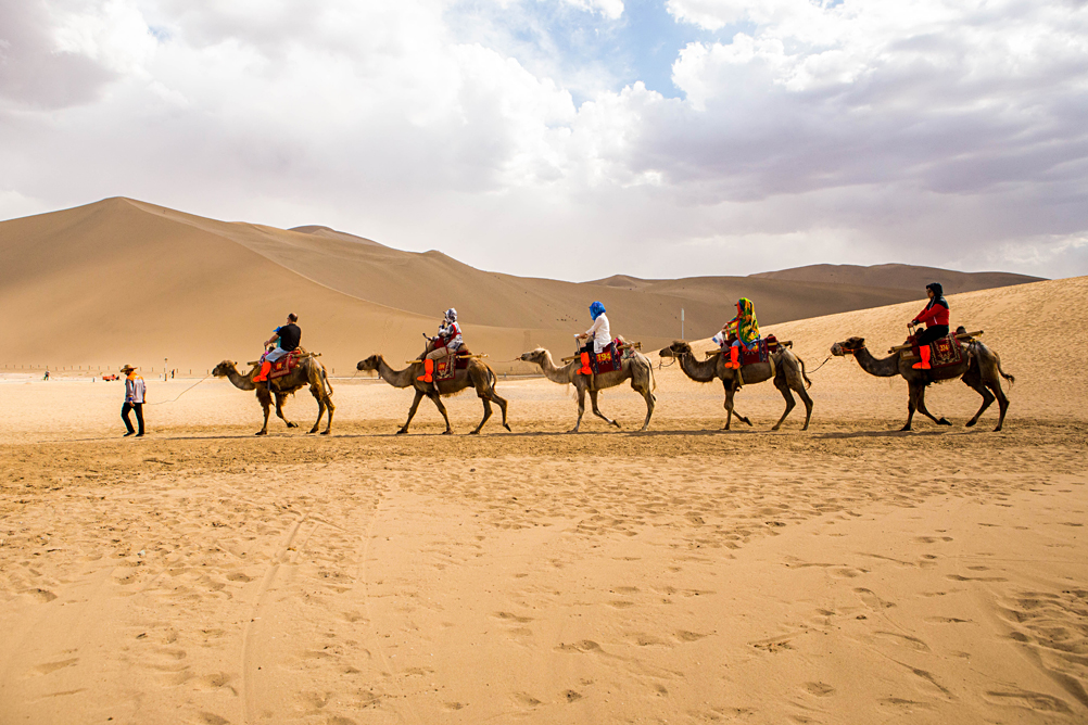 Camel Riding in the Deserts of Dunhuang, Gansu Province, China