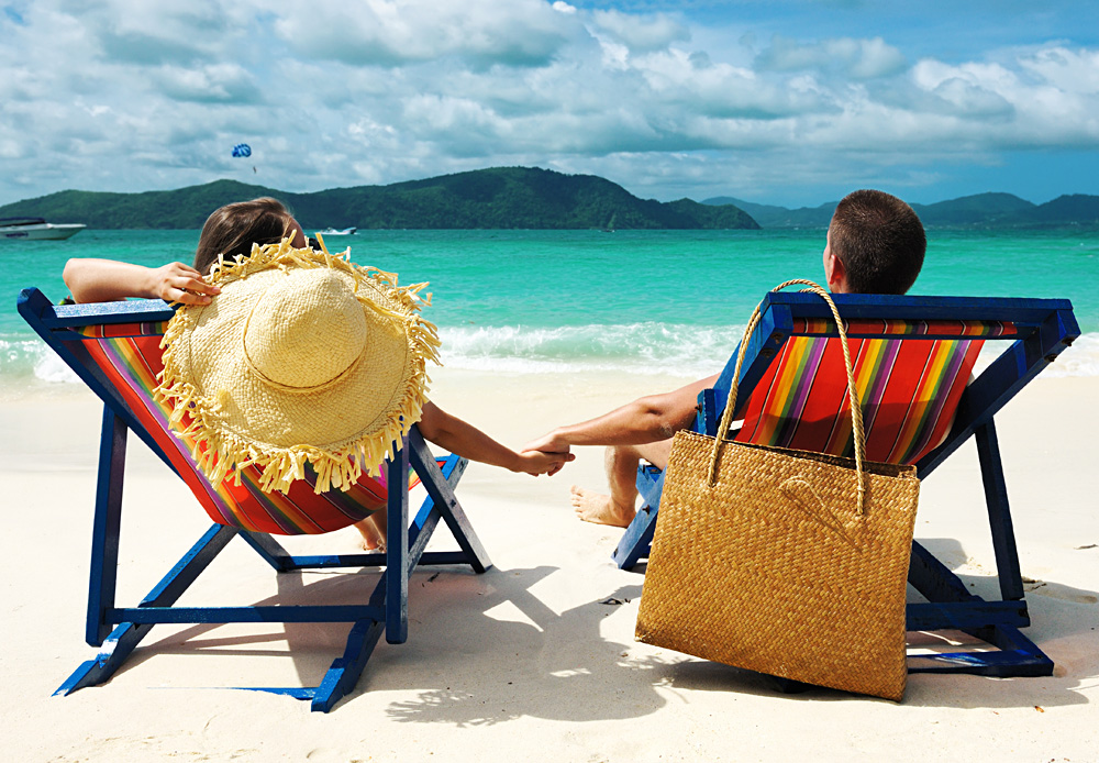 Couple holding hands on a Beach in Phuket, Thailand