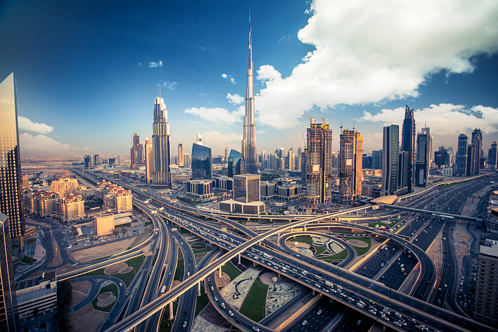 Dubai skyline with beautiful city close to it's busiest highway on traffic, United Arab Emirates (UAE)