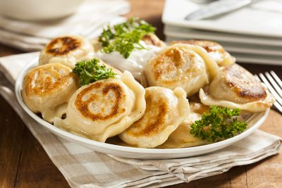 Homemade Polish Pierogis with Sour Cream and Parsley, Poland