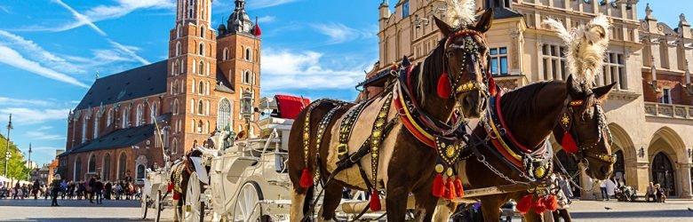 Horse Carriages at Main Market Square in Krakow in a summer day, Poland