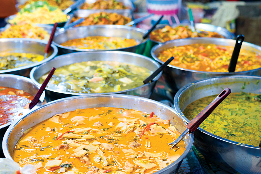 Various Thai Curries sold in street markets, Bangkok, Thailand