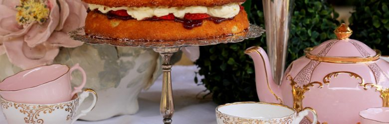 Victoria Sponge Cake with strawberries and cream on a vintage silver cake stand for afternoon tea, England, UK (United Kingdom)
