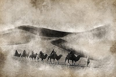Vintage background image of Silk Road Traders on Camel in China