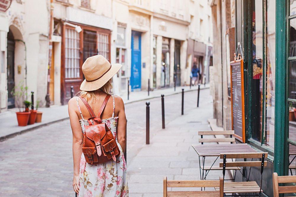 Young woman tourist walking on a street in Europe