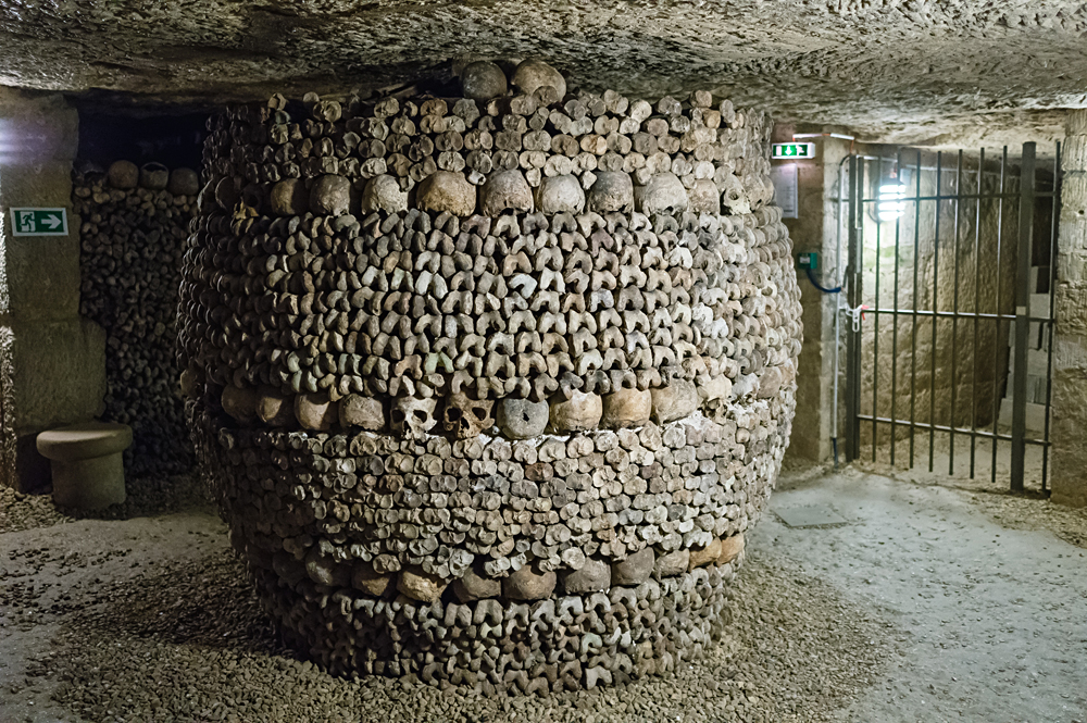 A pillar decorated by skull and bones in the Paris Catacombs, France