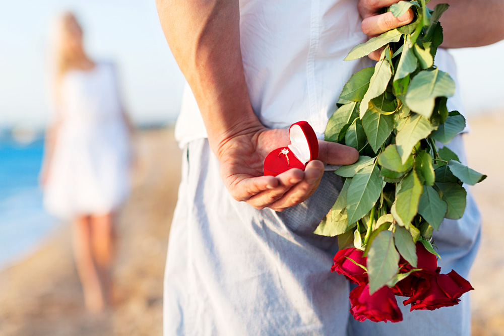 Beach Proposal Anticipated with Ring and Roses