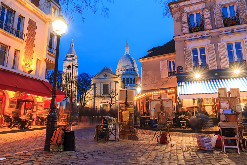 Beautiful evening view of the Place du Tertre and the Sacre-Coeur in Montmartre, Paris, France