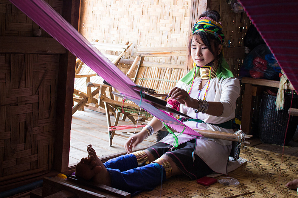 Burmese woman weaving cloth from lotus silk, Inle City, Shan State, Myanmar