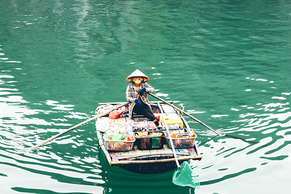Michaela Trimble - Approaching Local Vendor Paddling to Our Boat, Halong Bay, Vietnam