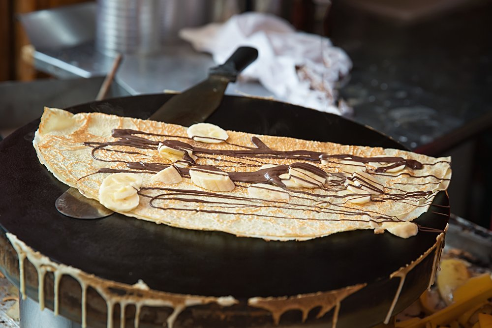 Pancake made by a Paris Creperie street vendor, France