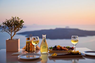 Romantic dinner for two at sunset in Santorini, Greece