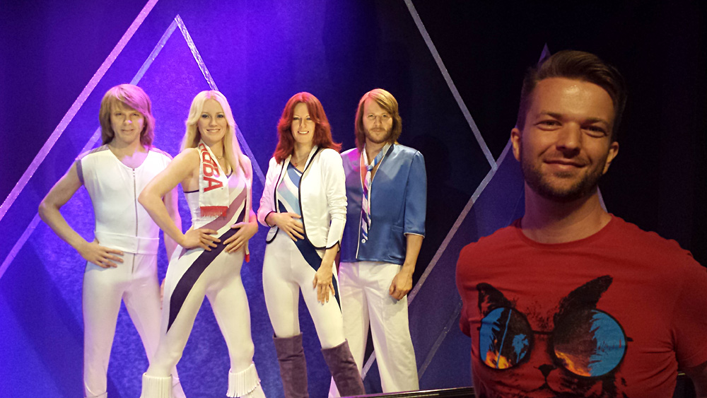 Christian Baines - Chris with wax figures of ABBA at the ABBA Museum, Stockholm, Sweden