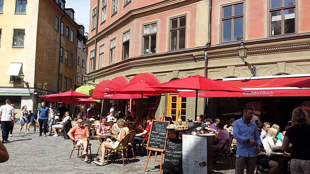 Christian Baines - Dining streetside in Galma Stan, Stockholm, Sweden