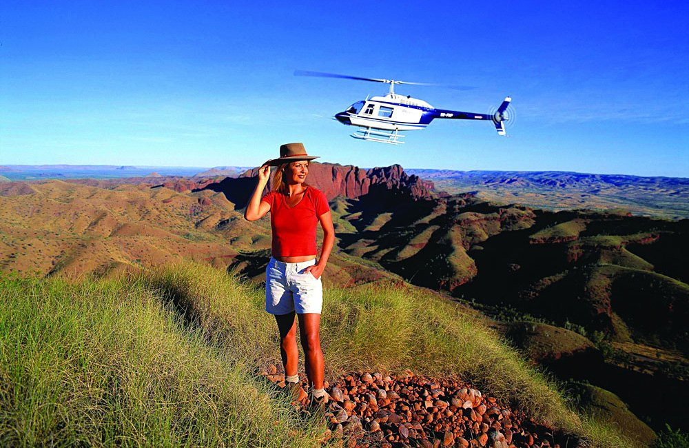 Hiking and Helicopter, with Ragged Range in the Background in the East Kimberley, Credit Tourism Western Australia