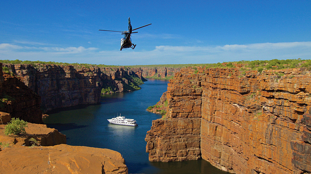True North Adventure Cruise - Helicopter inbound over King George River, Kimberley, Western Australia, Australia