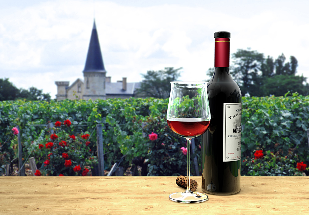 Wine bottle and glass of fictitious Bordeaux red wine with a chateau in the background, Bordeaux, France