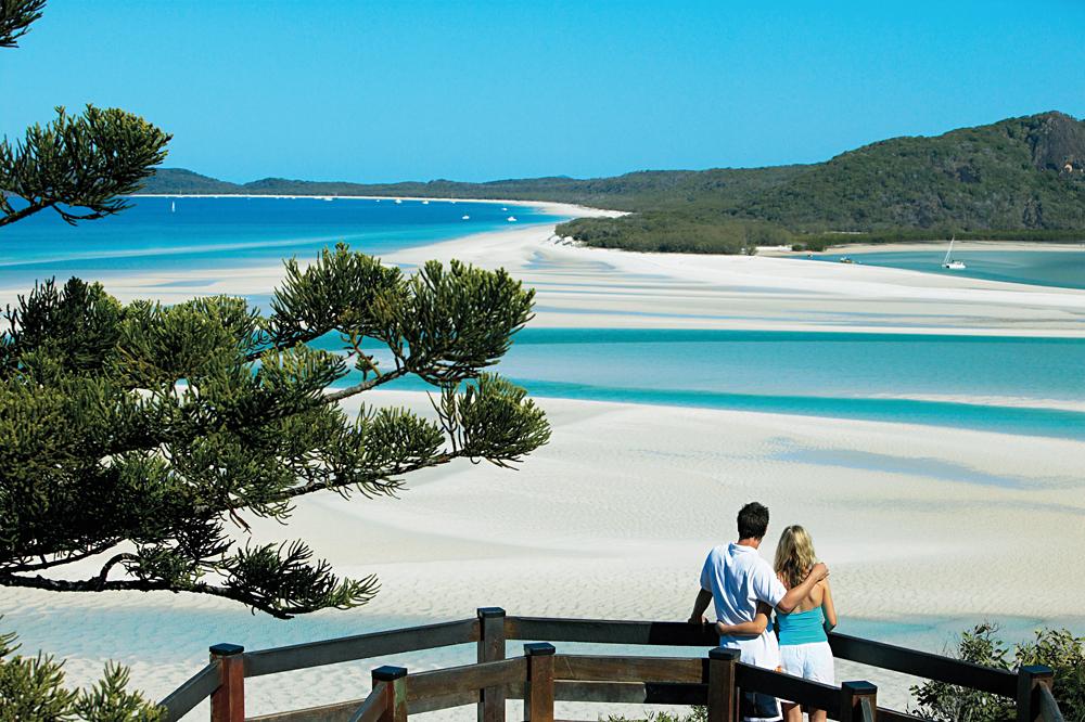 Couple Overlooking Whitehaven Beach, Whitsundays, Queensland, Australia
