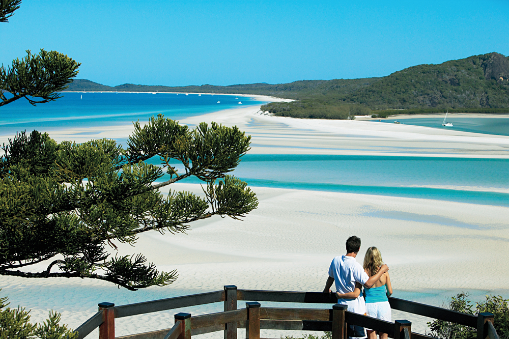 Couple Overlooking Whitehaven Beach, Whitsundays, Queensland, Australia
