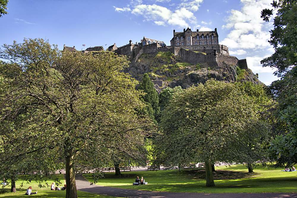 Edinburgh Castle perched on Castle Rock, overlooking the city park, Edinburgh, Scotland, UK (United Kingdom)