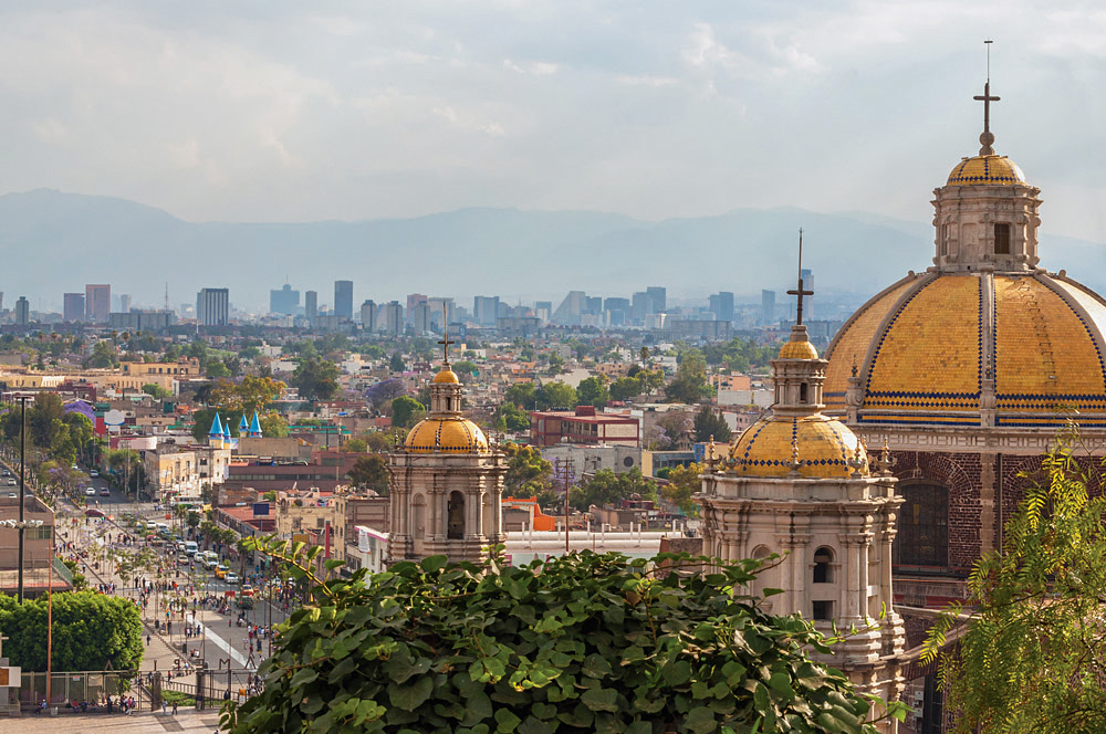 Old Basilica of Guadalupe with Mexico City skyline in Background, Mexico
