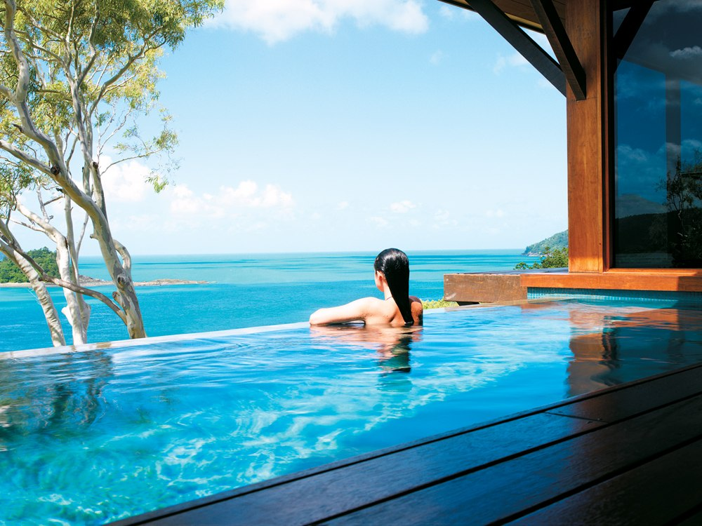 qualia Resort - Woman in Private Plunge Pool, Whitsundays, Queensland, Australia