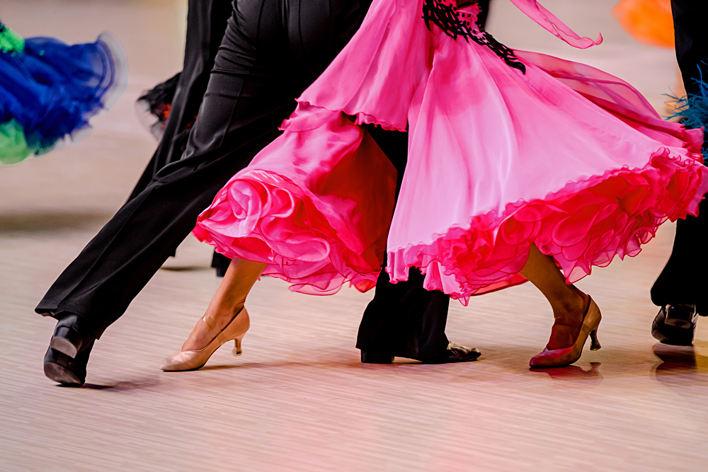 Ballroom dancers in black tailcoat and pink ball gown