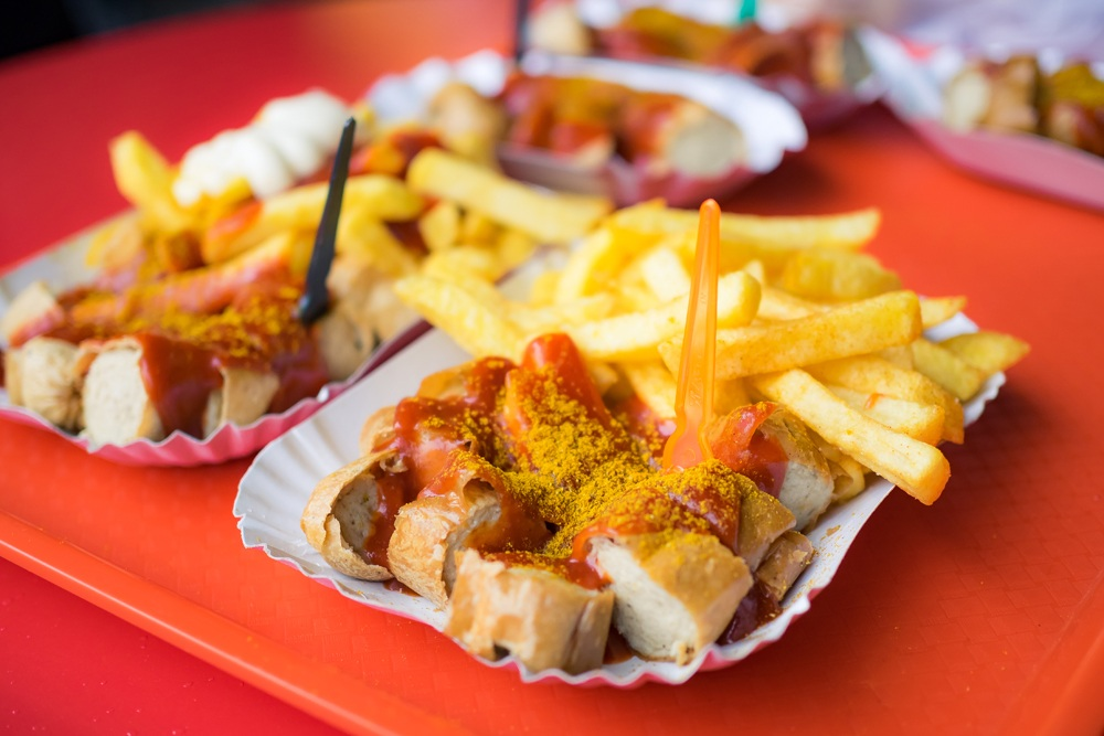 Currywurst with French fries in Berlin, Germany