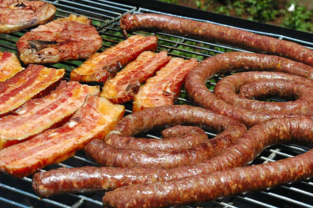 Grilling meats, including boerewors at a South African Braai, South Africa