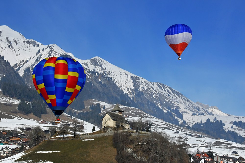 Hot air balloons over the Swiss Alps, Switzerland