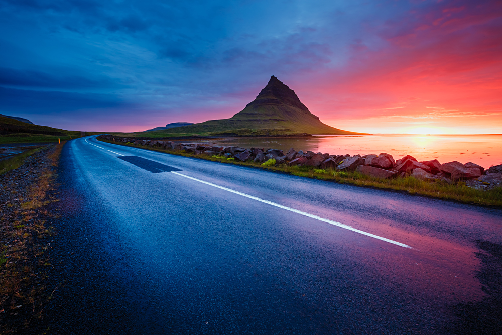 Kirkjufell volcano in the evening from the coast of Snaefellsnes Peninsula, Kirkjufellsfoss, Iceland
