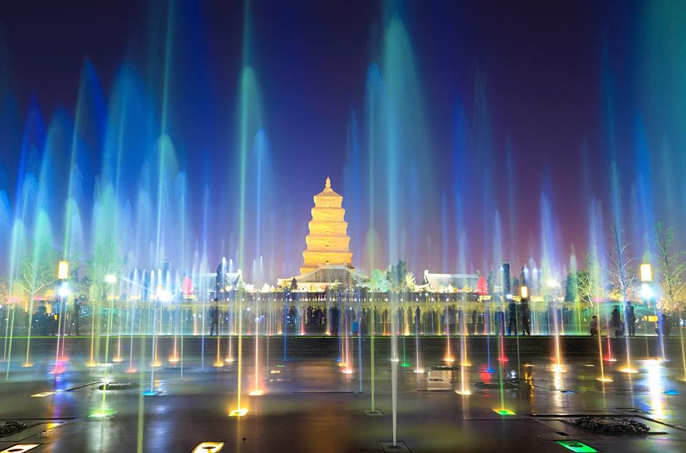 Big Wild Goose Pagoda at night with fountains, Xian, China