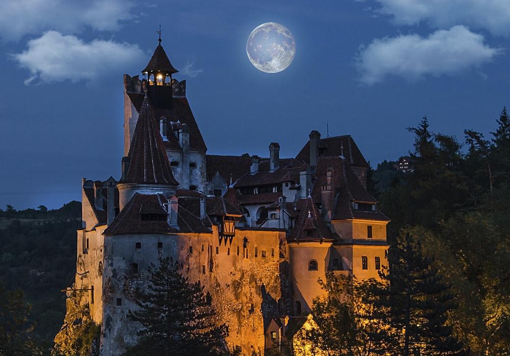 Bran Castle at Night with Full Moon, Transylvania, Romania - Cropped
