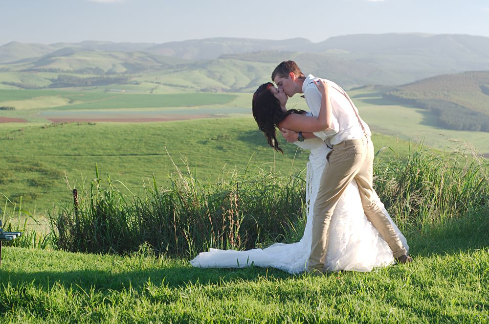 Bride and groom with African Natal Midlands mountain scenery, South Africa