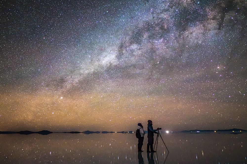 Couple Enjoying Milky Way at Uyuni Salt Flats, Bolivia