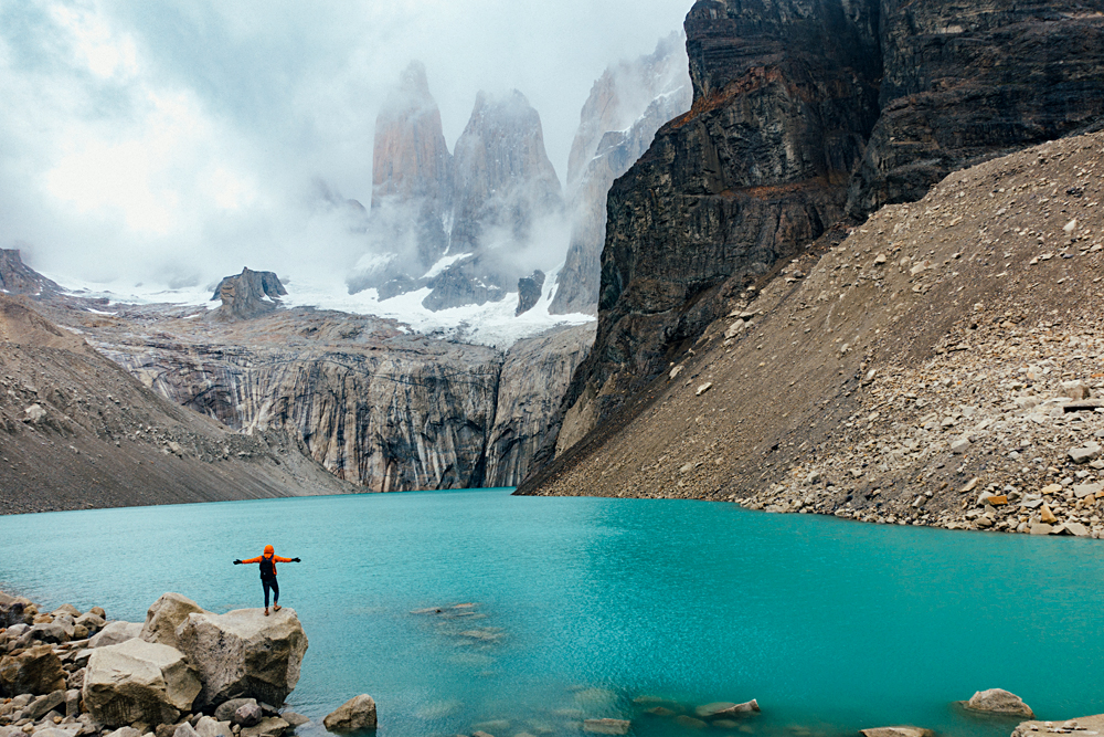 Man standing in front of Torres del Paine, Patagonia, Chile
