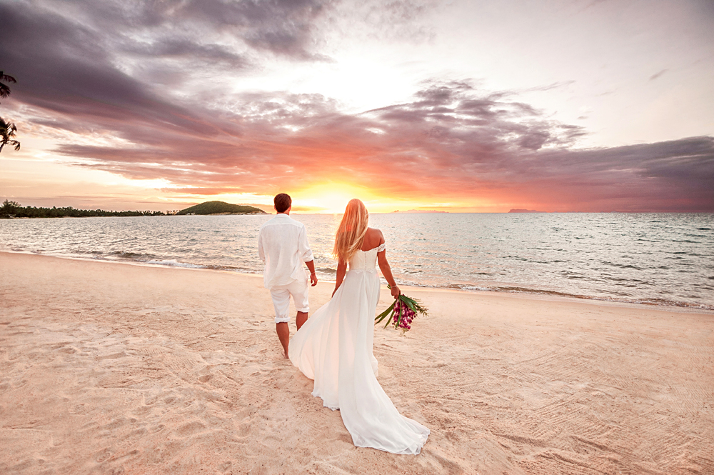 Newly married young couple by the sea, Thailand