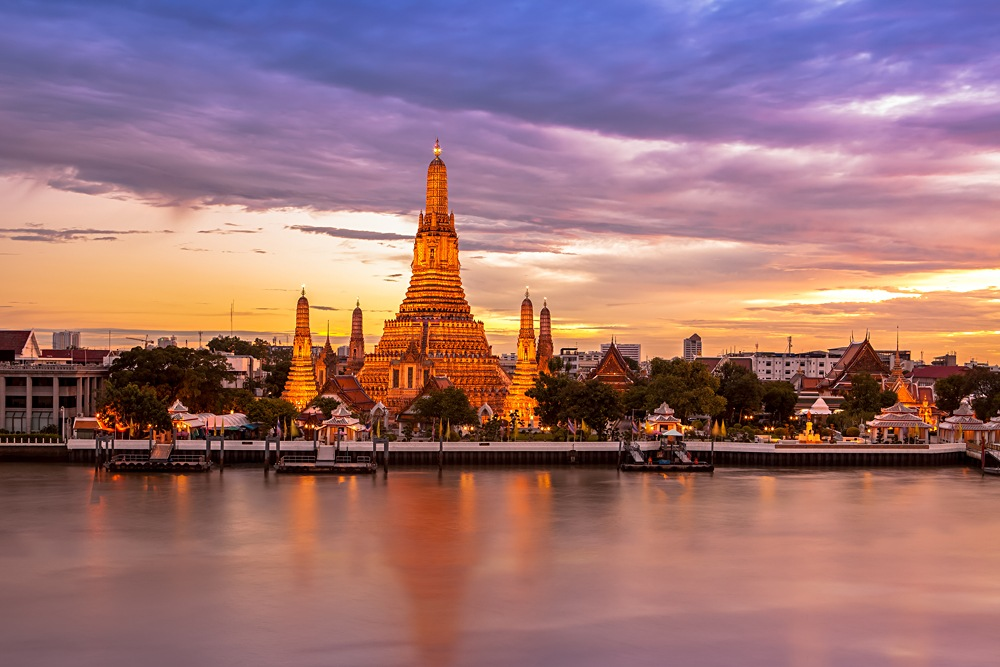 Phra Prang Wat Arun along the Chao Phraya River at twilight, Bangkok, Thailand