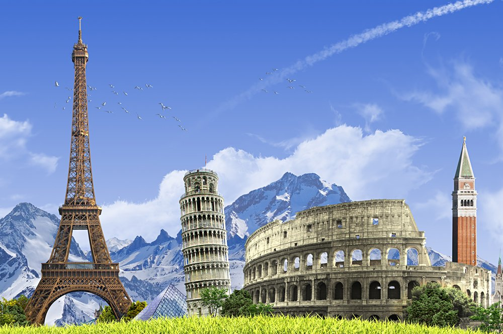 Summer travel across Europe - famous landmarks and grassy hill over blue sky