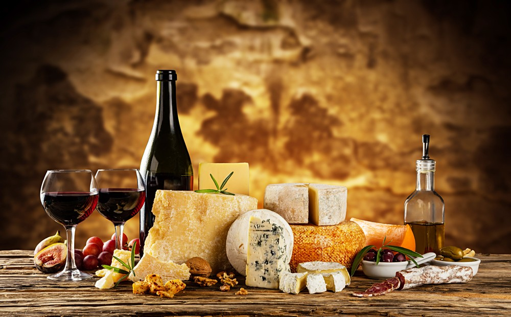 Wine and traditional pieces of french and italy hand-made cheese, France, Italy